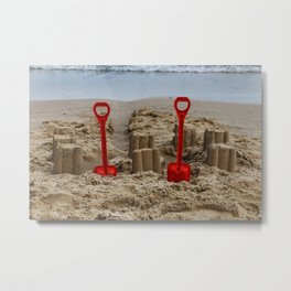 sandcastles and red spades on the beach Metal Print