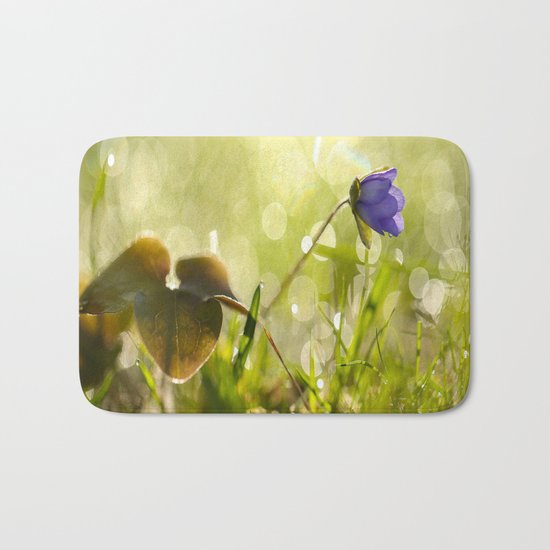Beautiful spring - first flower little anemone with beautiful bokeh in green background Bath Mat
