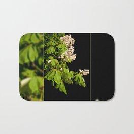 blooming Aesculus tree on black Bath Mat