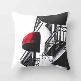 building with porch and red awning in the city Throw Pillow