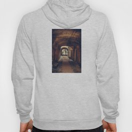 Silhouette of a man at the end of the tunnel in a medieval city Hoody