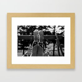Playing on the swing Framed Art Print