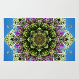 Intricate floral kaleidoscope - Vebena, Dichondra leaves with blue sky Rug