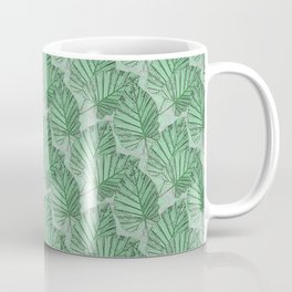 Green leaves on a gray stone. Coffee Mug