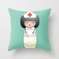 nurse Throw Pillows featuring Kokeshi Nurse by Pendientera