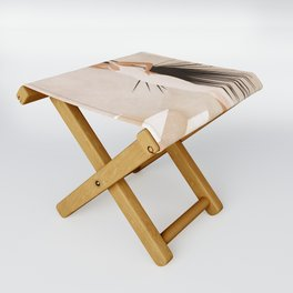Minimal Woman with a Palm Leaf Folding Stool