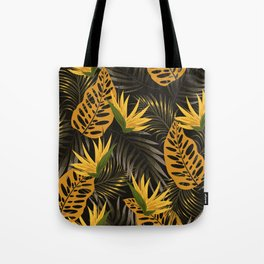 Original seamless tropical pattern with bright plants and leaves on a black background. Tropic leaves in bright colors. Seamless exotic pattern with tropical plants. Hawaiian style. Tote Bag