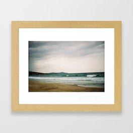 Stormy day on the beach Framed Art Print