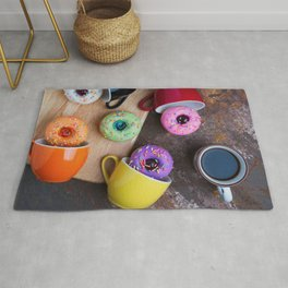 Fancy donuts with black coffee Rug
