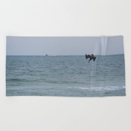 Diving for fish Beach Towel