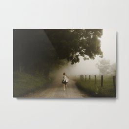 woman running down a lane in the country morning fog Metal Print