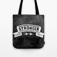 crossfit Tote Bags featuring Stronger Every Day (dumbbell, black & white) by Lionheart Art