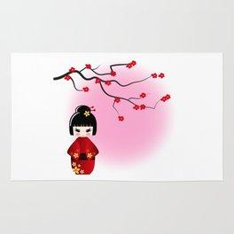 Japanese kokeshi doll at sakura blossoms Rug