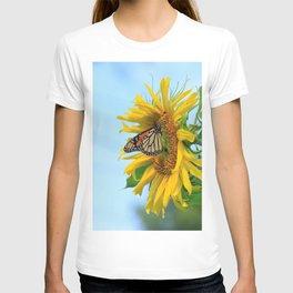Monarch Butterfly on a Kansas Sunflower in a Garden with blue sky. T-shirt