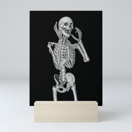 Skeleton screaming in horror Mini Art Print