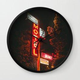 Motel at night Wall Clock