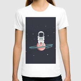 Astronaut sits on Saturn T-shirt