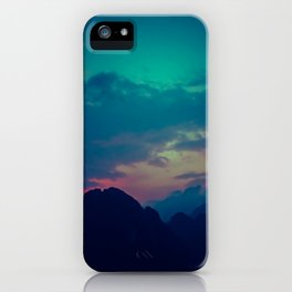 Blue and pink evening sky over the limestone mountains in the Vang Vieng province in Laos. iPhone Case
