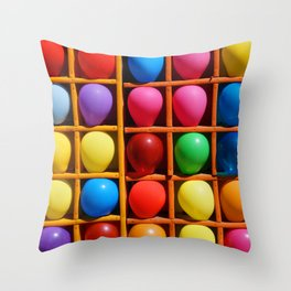 colorful balloons in wooden boxes, attraction Throw Pillow