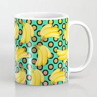 banana leaf Mugs featuring banana by mark ashkenazi