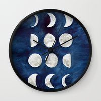 moon phases Wall Clocks featuring Moon phases by Bridget Davidson