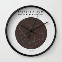 nan lawson Wall Clocks featuring There Is A Light by Nan Lawson