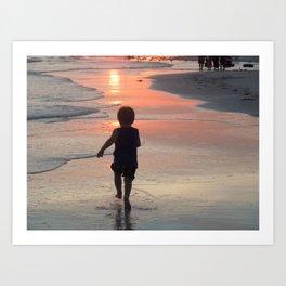 Beach sunset child in shawdow running Art Print