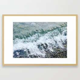 Waves lap at the shore Framed Art Print
