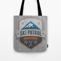 ski Tote Bags featuring Ski Patrol by Nezz