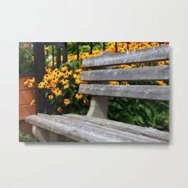 Seat in the park with yellow flowers Metal Print