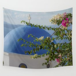 Blue dome church and flowers in Santorini, Greece Wall Tapestry