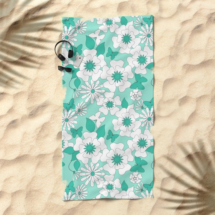 Turquoise floral pattern . Beach Towel