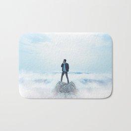 Man standing on the rock Bath Mat