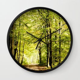 A pathway covered by leaves in a magical forest Wall Clock
