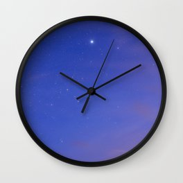 Star Sirius over the mountains at sunset. Constelation Canis Mayor Wall Clock