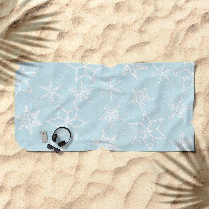 Snowflakes on light blue background Beach Towel