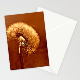 glowing dandelion on bright marsala Stationery Cards