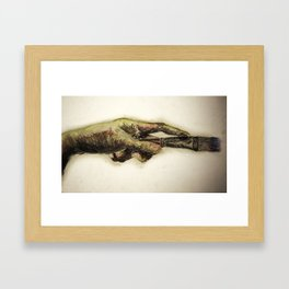 Painters hand with brush Framed Art Print