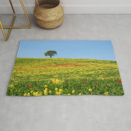 Lonely tree on a flowerd field. Rug