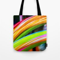 games Tote Bags featuring Colorful Games by Nathalie Photos