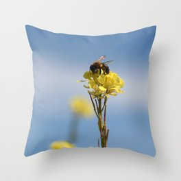 Honey bee on a wildflower Throw Pillow