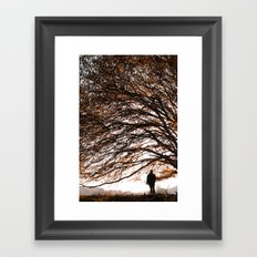 Under the safe arms of the tree Framed Art Print
