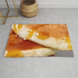 Detail of homemade pancakes wet with maple syrup Rug