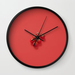 Red cherry tomatoes on a red background Wall Clock