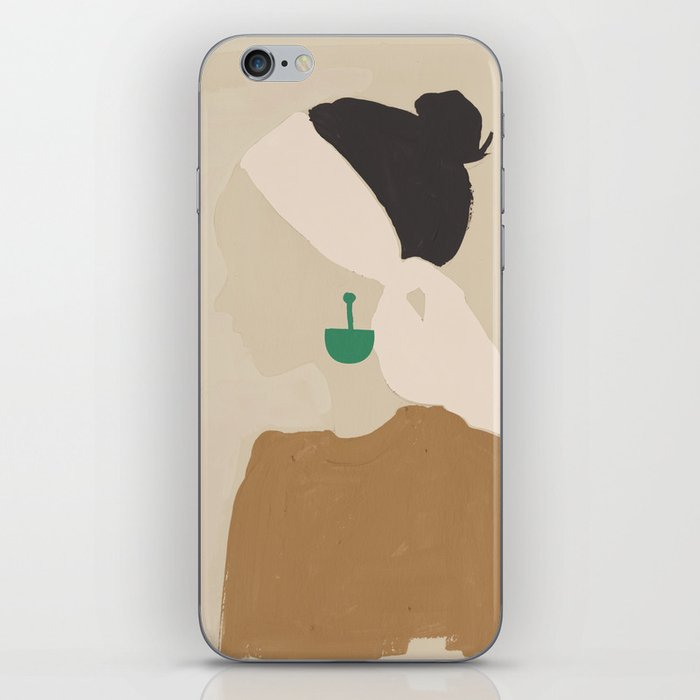Minimalist Woman with Green Earring iPhone Skin
