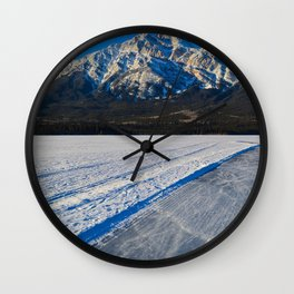 Pond hockey & Skating on Pyramid Lake in Canada Wall Clock