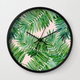 Green palm leaves on a light pink background. Wall Clock