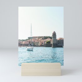 SAILBOAT - BY - SEAPORT - IN - SUNLIGHT - PHOTOGRAPHY Mini Art Print