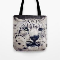 snow leopard Tote Bags featuring Snow Leopard by Angela Dölling, AD DESIGN Photo + Photo