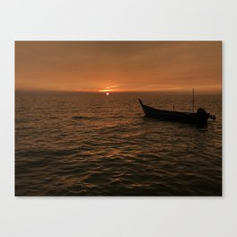 Sunset view with small boat, sampan at the seaside Canvas Print